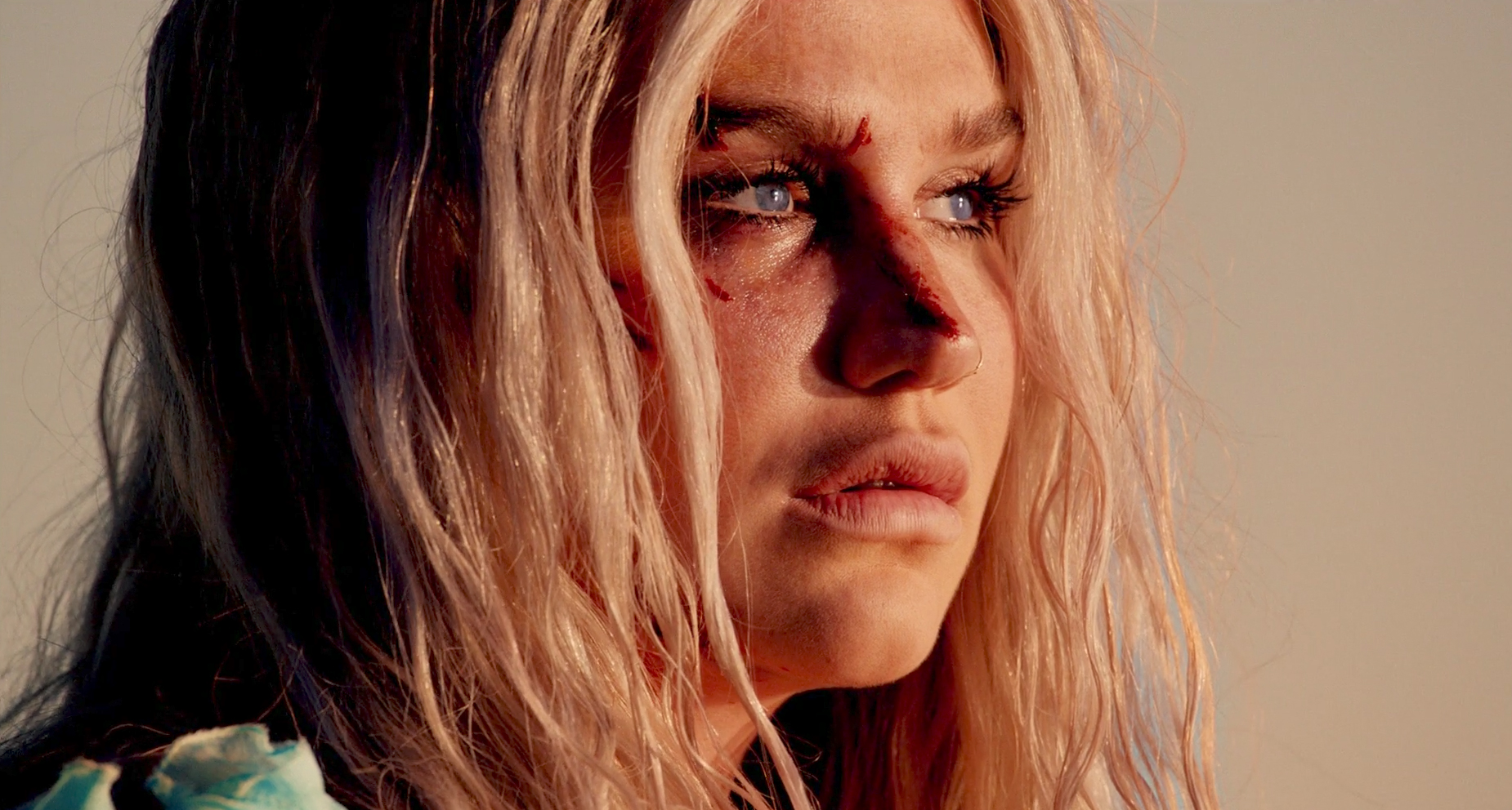 "Review: Kesha Makes a Defiant Return with Powerful New Single and Video ""Praying"""